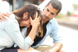 Muslim man comforting a sad girl mourning