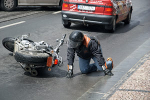 The man fell off a motorcycle Harley Davidson