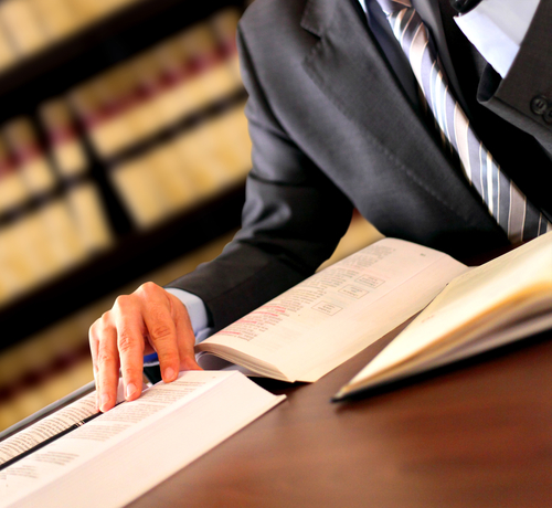 medical malpractice attorney studying a case